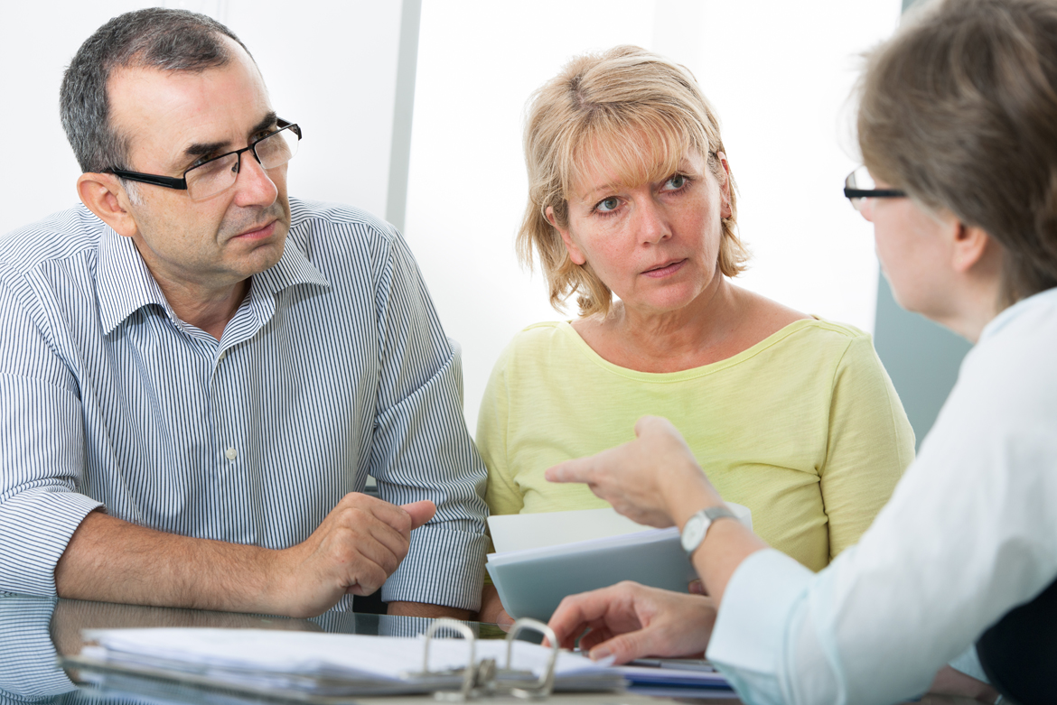 man and woman receiving financial advice